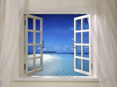 Window on a white wall opened to a blue sky