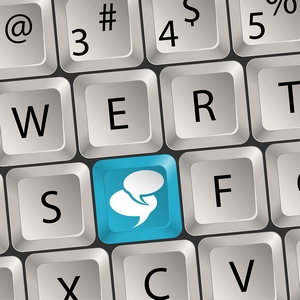 "qwerty keabord with blue ""chat bubble"" key"