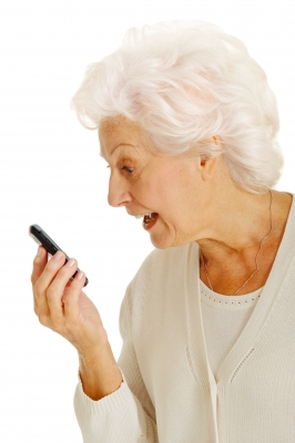 Grandma using cell phone loudspeaker